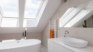 Picture of a new skylight installation in a bathroom.  The skylight was installed by Belleville Roofing Services located in Belleville, Ontario.